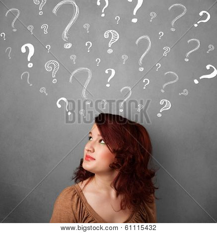 Pretty young woman thinking with sketched question marks all over her head