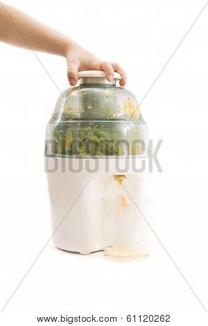 Child Hand Pressed On Juice Maker