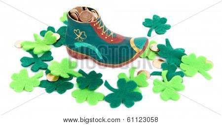 Saint Patrick day boot with gold and clover leaves, isolated on white