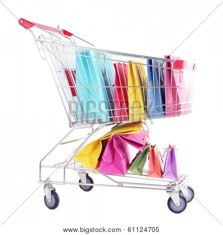Colorful shopping bags in shopping trolley, isolated on white