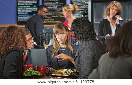 Skeptical Business Woman With Group