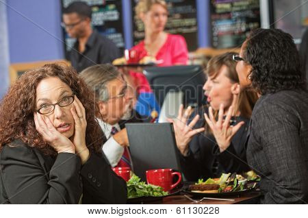 Bored Woman With Co-workers In Cafe