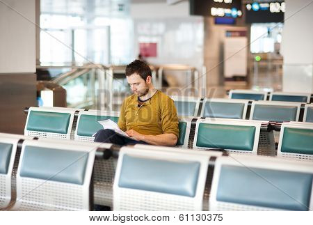 Young man using a tablet at airport