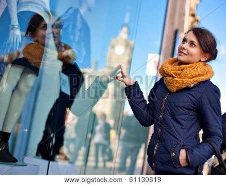 Girl Is Looking At Shop Window