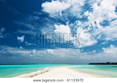 Beautiful island beach with sandspit at Maldives