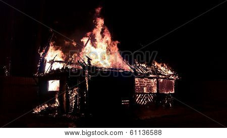 Wooden House On Fire At Night