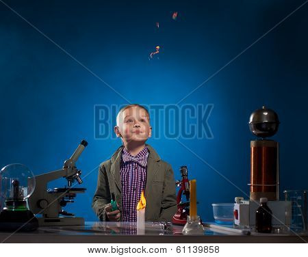 Curious experimenter watching flying fire in lab