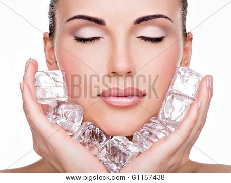Beautiful Young Woman Applies The Ice To Face