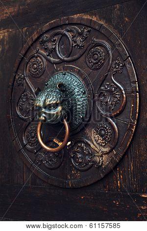 Antique Knocker On A Wooden Door, Augsburg, Germany