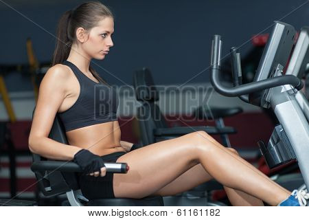 Sportive Woman Doing Exirsise On Cycling Simulator