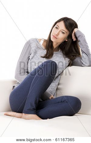 Beautiful woman sitting on the coach and relaxing