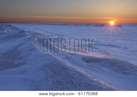 Sun Setting Over Frozen Lake Huron
