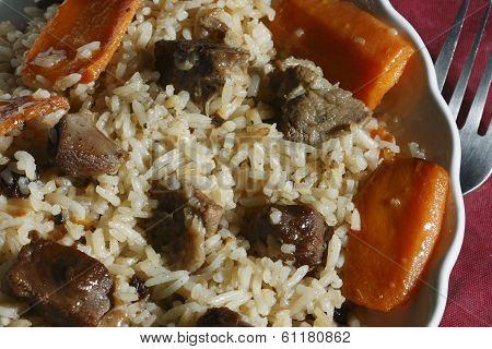 Qabili Pilau - A Rice Preparation Made With Lamb, Carrots And Raisins