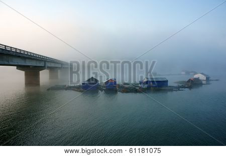 Bridge, Fishing Hamlet On Lake In Fog