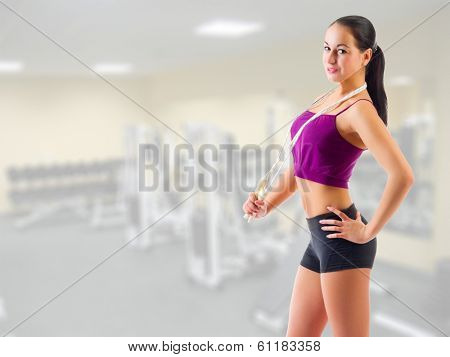Young sporty girl with skipping rope at gym club