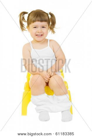 Little curious girl on chamberpot isolated background