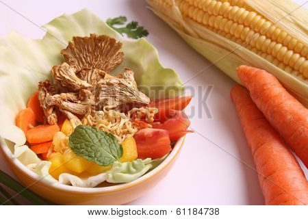 Indian Food Ingredients On A White Background(bell Peppers, Capsicum, Cabbage, Corn On Cob, Carrots,