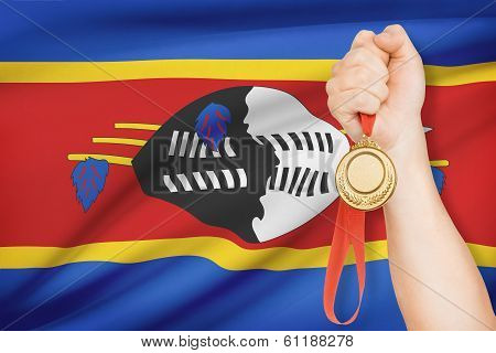 Medal In Hand With Flag On Background - Kingdom Of Swaziland