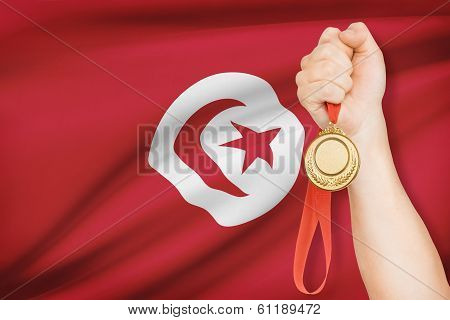 Medal In Hand With Flag On Background - Tunisian Republic