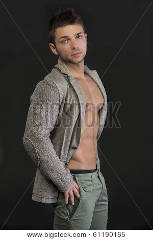 Profile Of Young Man With Open Jacket On Muscular Torso