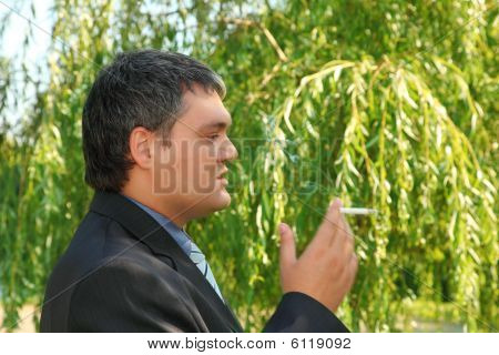 Smoking Businessman Outdoor In Summer