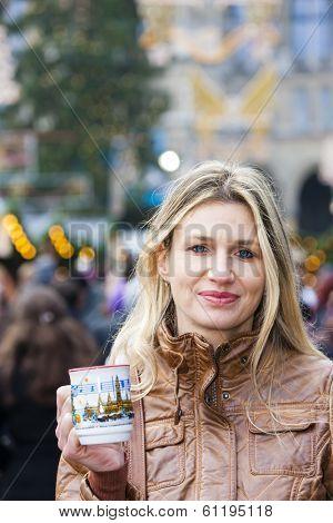 woman drinking hot wine at Christmas market, Vienna, Austria