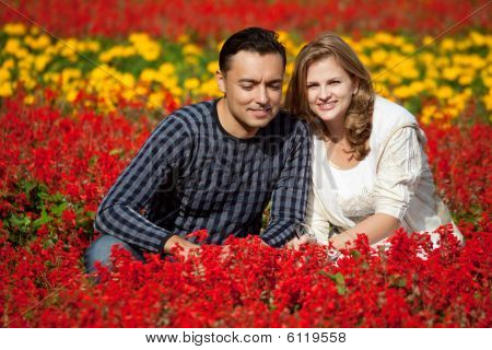 Man And Woman In Braces In Flowering Park
