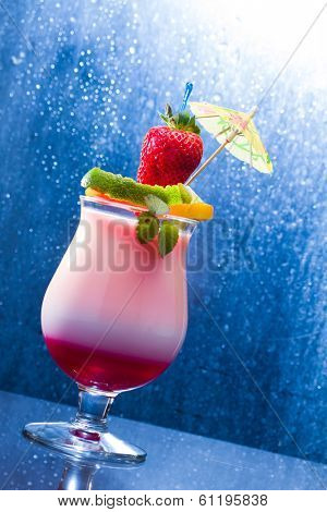 Fresh tropical cocktail with strawberry and mango
