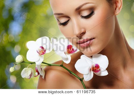 Beautiful Woman With A White Orchid