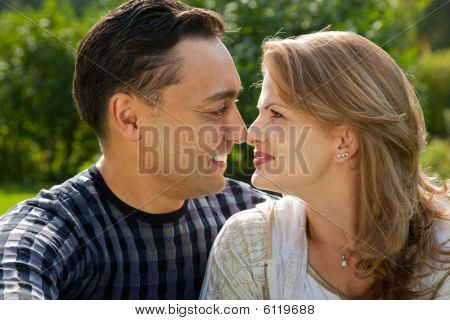 Young Loving Couple Face To Face Outdoors