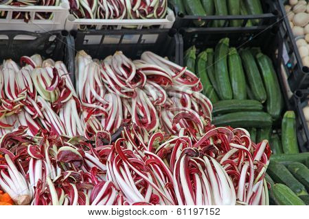 Red Treviso Radicchio And Green Zucchini Sold At The Market Stand