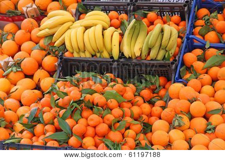 Banana Yellow And Orange Tangerines And Other Fruits For Sale At The Market
