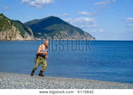 Soldier Runs At Sea