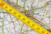 stock photo of meter stick  - photo of road map of milan with measuring stick - JPG
