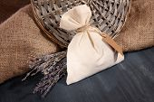 foto of sachets  - Textile sachet pouch with dried lavender flowers on wooden table - JPG