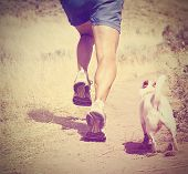an athletic pair of legs  - healthy lifestyle concept done with a retro vintage instagram filter