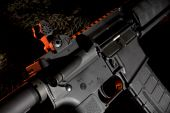 stock photo of ar-15  - ar15 on a dark background with red highlights from behind - JPG