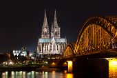 image of koln  - Riverside view of the Cologne Cathedral and railway bridge over the Rhine river Germany - JPG