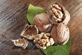 pic of walnut  - whole walnuts and walnut fruit with leaf - JPG