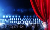 image of opulence  - Hand of businessman opening red velvet curtain - JPG
