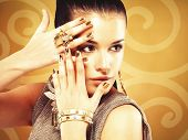 Beautiful Woman With Golden Nails And Beautiful Gold Ring
