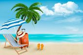 stock photo of sunny season  - Beach with palm trees and beach chair - JPG