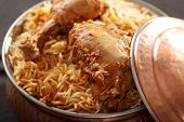 pic of biryani  - Hyderabadi Biryani - is perhaps the most well-known Non-Vegetarian culinary delights from the famous Hyderabad Cuisine. It is a traditional dish made using Basmati rice goat meat and various other exotic spices.