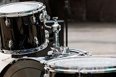 picture of drum-kit  - Black drum kit on stage ready for play - JPG