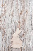 Easter Decoration With Wooden Rabbit On Old Wood