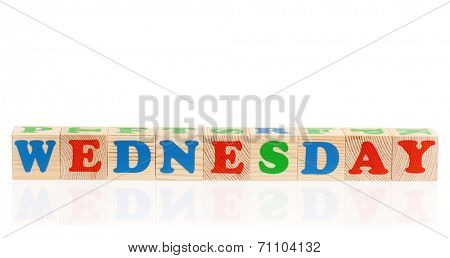 Word wednesday formed by wood alphabet blocks, isolated on white background
