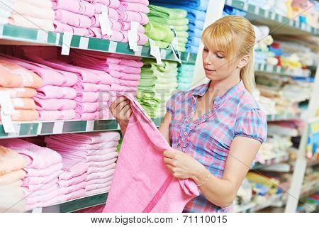 woman choosing bath towels textile in apparel clothes shop supermarket