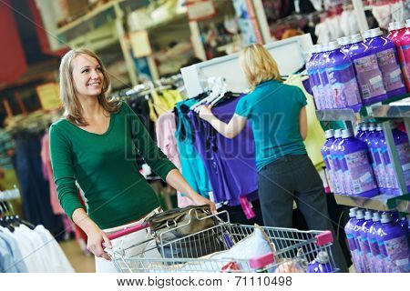 woman with shopping cart trolley in apparel clothes shop supermarket
