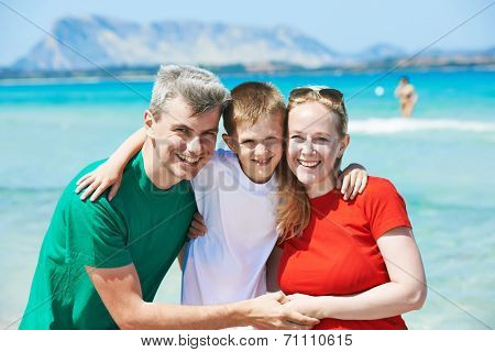 Family. Parents with child at sea beach