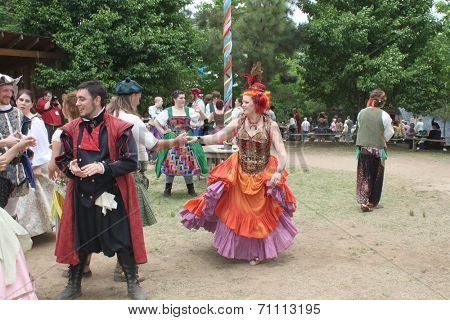 MUSKOGEE, OK - MAY 24: People dressed in historical costumes dance at the Oklahoma 19th annual Renaissance Festival on May 24, 2014 at the Castle of Muskogee in Muskogee, OK.